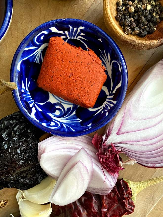 close up of achiote in small bowl