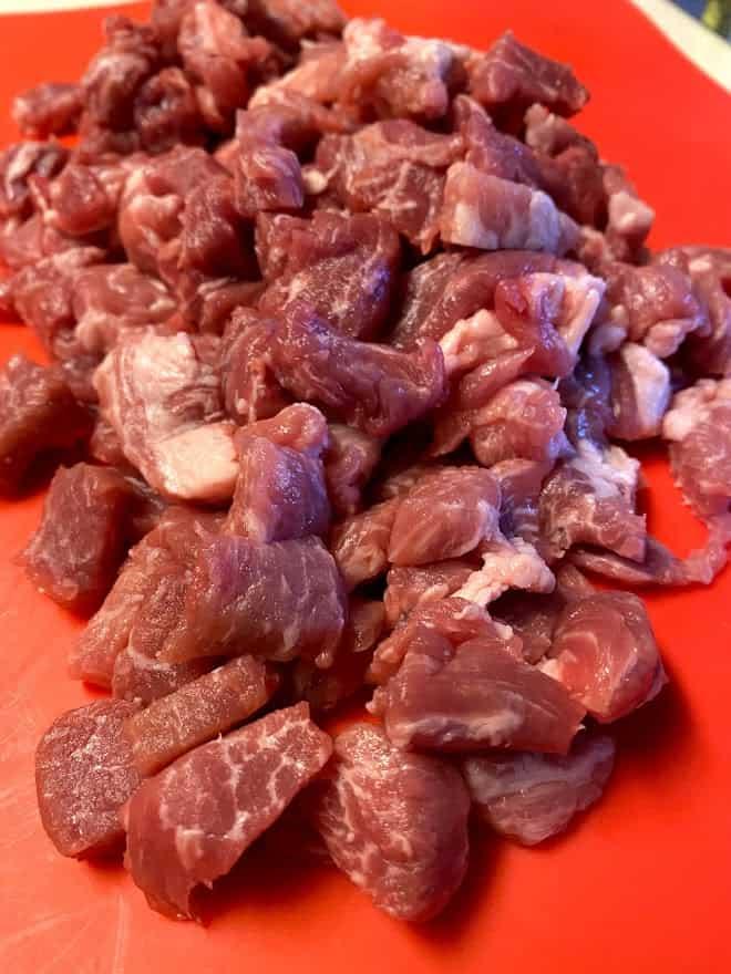 chopped pork butt meat on cutting board