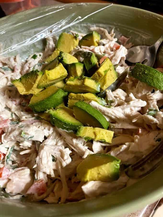 folding avocado into chicken salad
