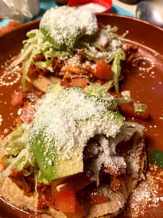 loaded chicken tinga tostadas up close