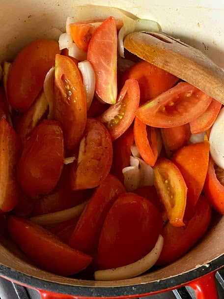 Onions, garlic and tomatoes in pot