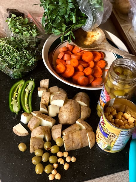 vegetables, garbanzo beans, olives and fresh herbs for stew