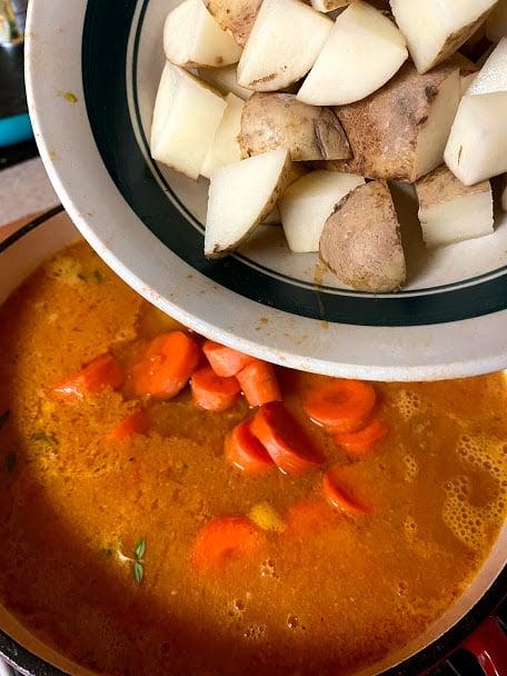Adding vegetables to pot