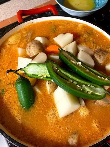 Adding jalapeños to pot