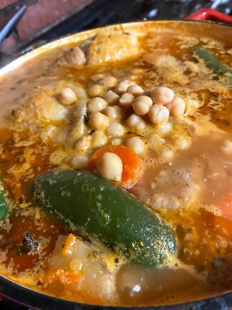 Adding garbanzo beans to the pot