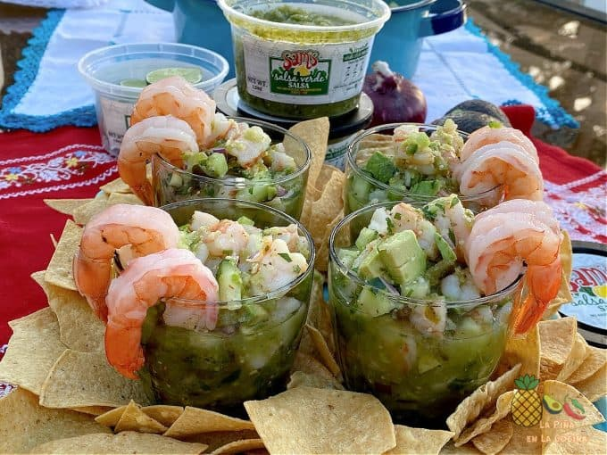 plated shrimp ceviche in 4 glasses with tortilla chips