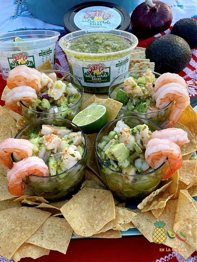 ceviche served in glassed with chips, sam's salsa verde in the backround