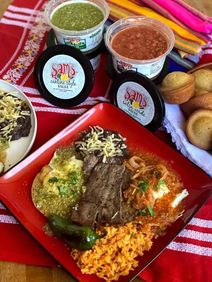 top view of huevos divorciados with red and green salsa on table