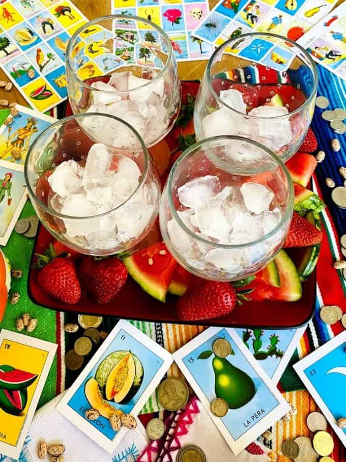 glasses for sangria filled with ice on platter