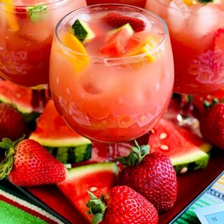 close up of sangria with fresh fruit