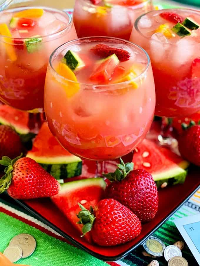 four glasses of sangria with fruit garnish