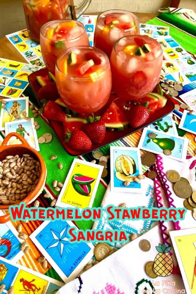 four glasses of sangria on a large plate with fresh fruit. Mexican loteria with coins and beans.
