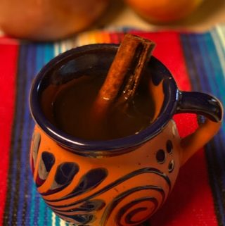cup of cafe de olla with cinnamon stick