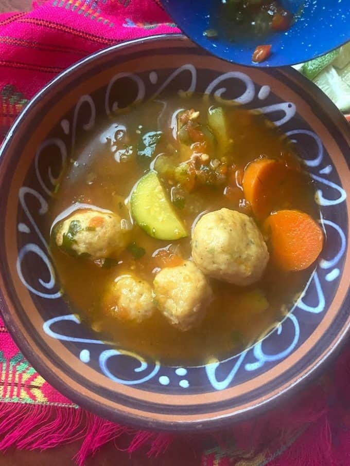 top view of shrimp meatballs with vegetables in broth