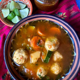 top view of shrimp meatballs with vegetables and broth