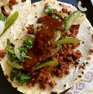 close up of longaniza taco