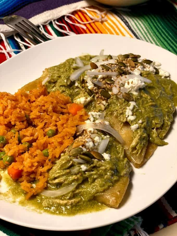 enmoladas plated with Mexican rice