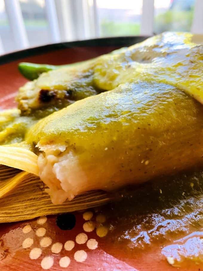 spicy salsa verde over tamales