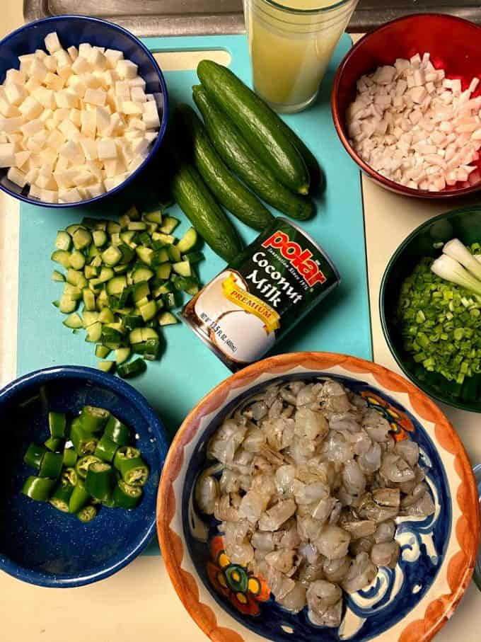 Ingredients for ceviche on cuttin board and counter