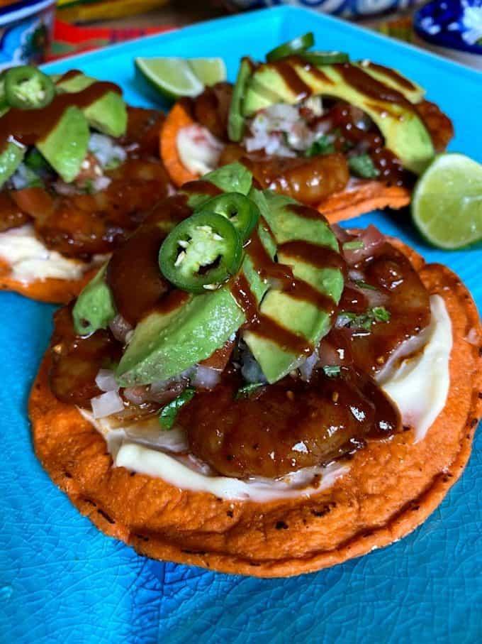 shrimp tostada with salsa negra up close