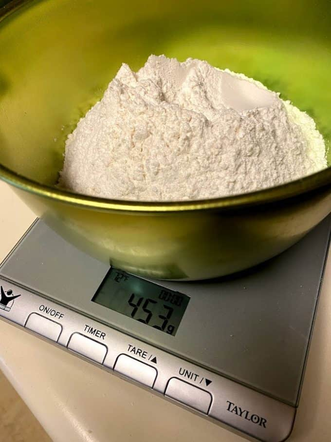 weighing out flour in a bowl on the scale