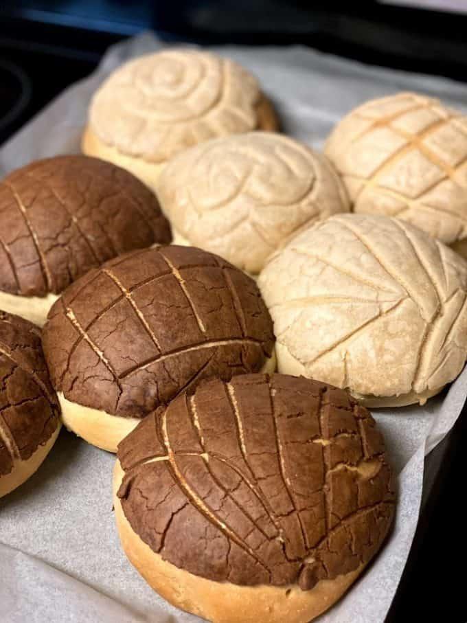 freshly baked conchas on baking sheet