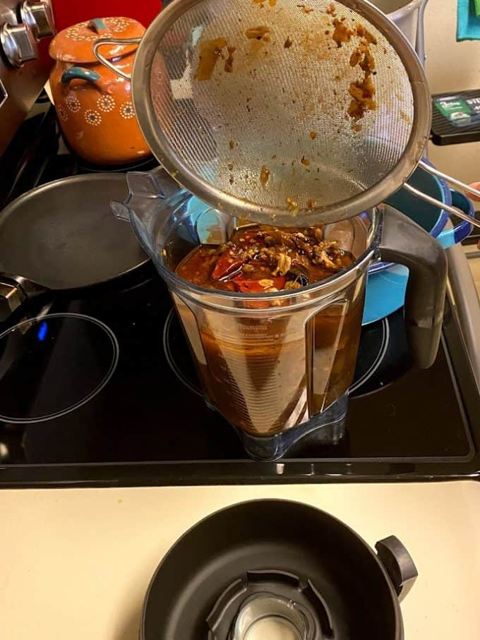 transferring ingredients into blender for consomme