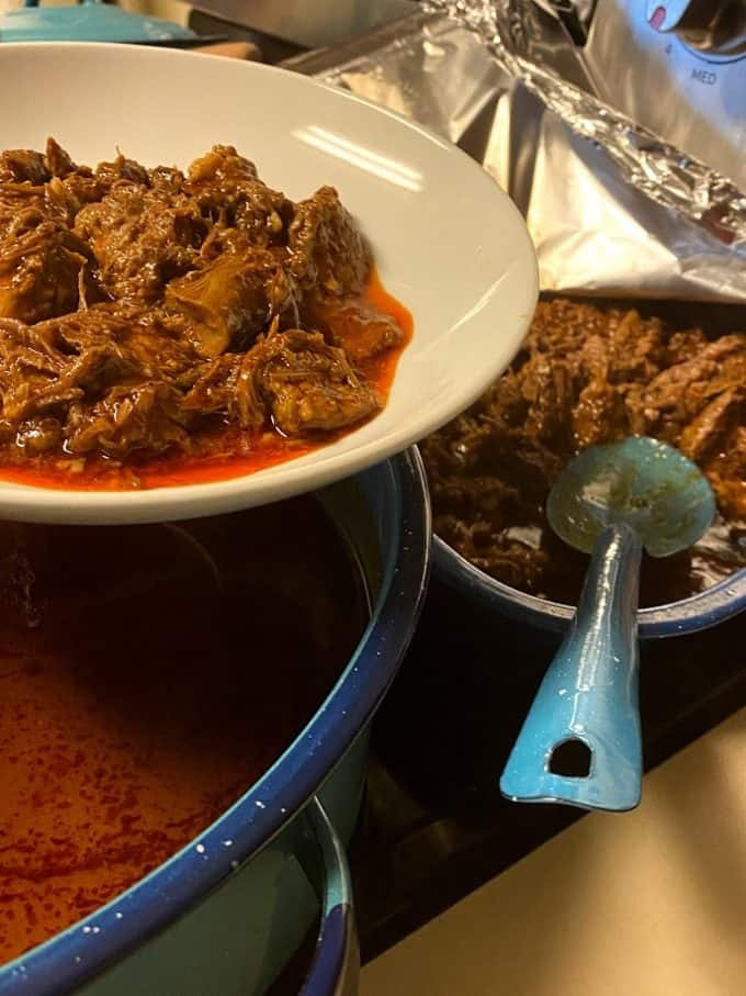 plating barbacoa in a shallow bowl