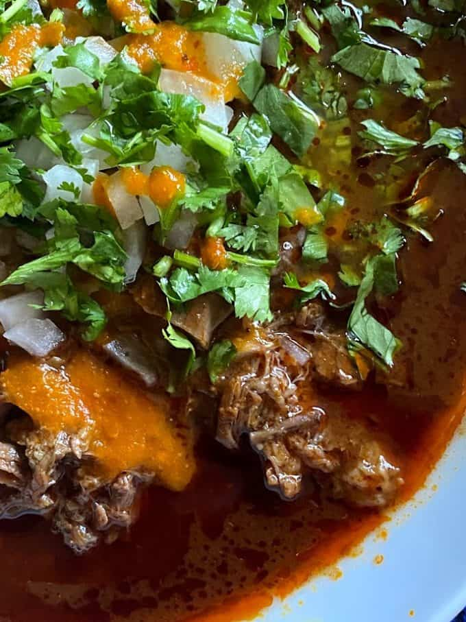 close up of barbacoa with consomme
