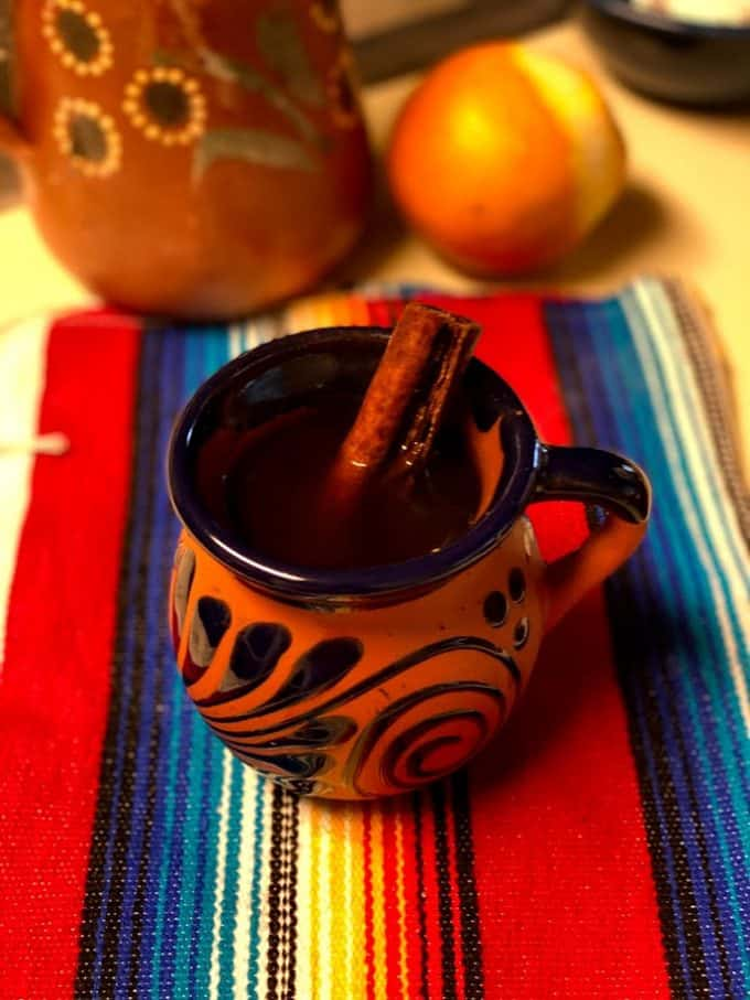 a cup of cafe de olla with cinnamon stick