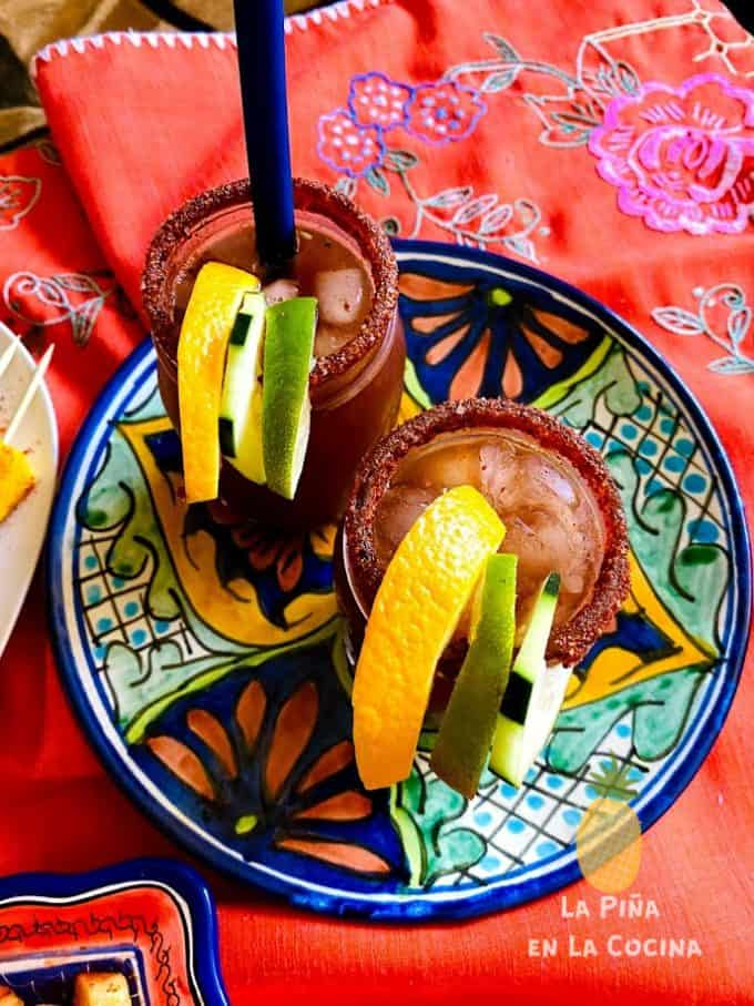top view of two micheladas with garnishes