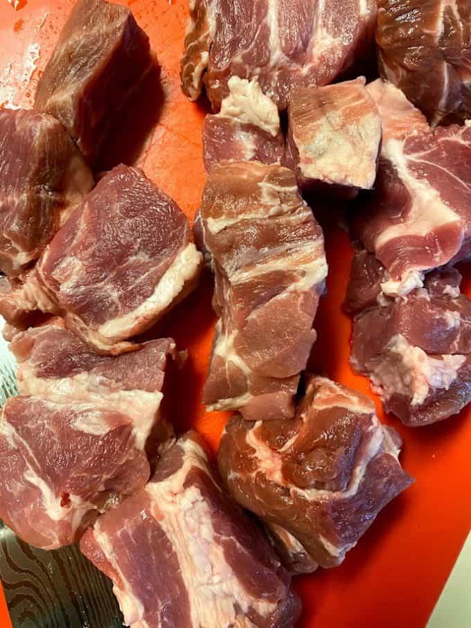 pork butt sliced in big chunks on cuttin board