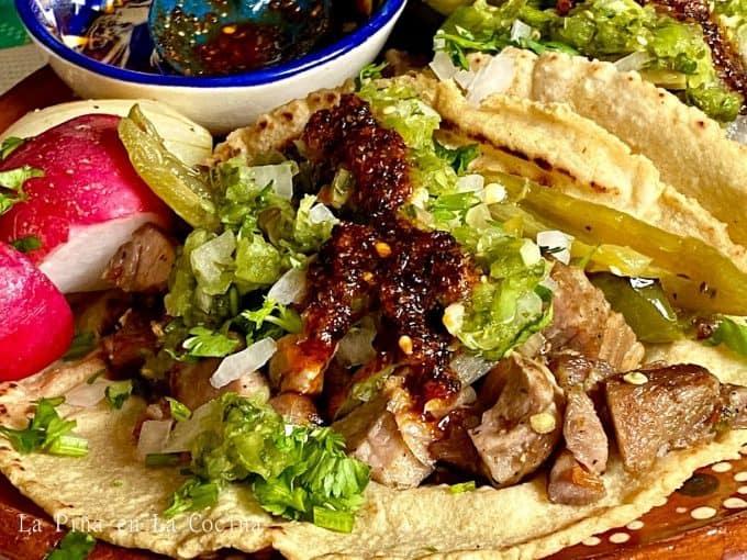 Pork Carnitas taco up close with salsa cruda and salsa macha