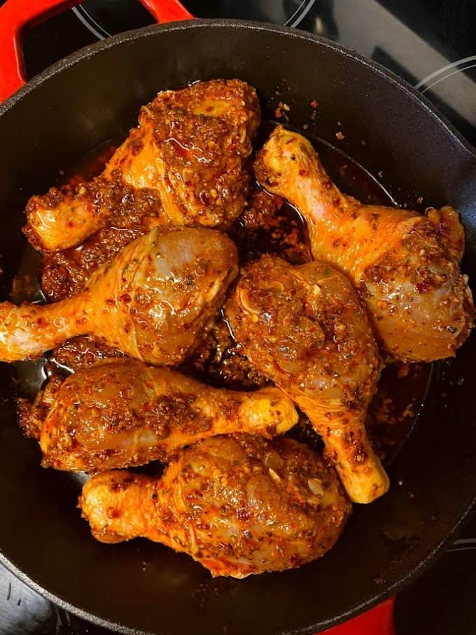 drumsticks skin side down in cast iron skillet ready for the oven