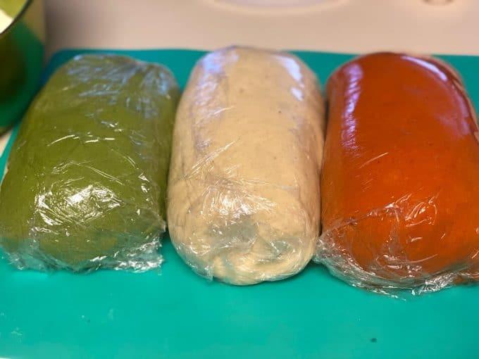 three colored masas wrapped in plastic