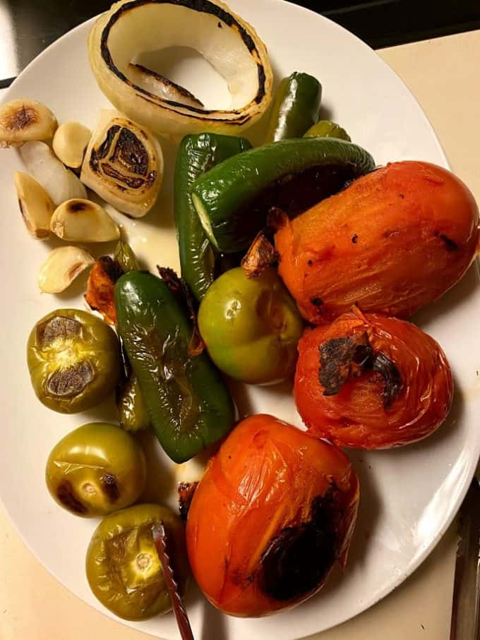 Dry roasted salsa ingredients on a plate