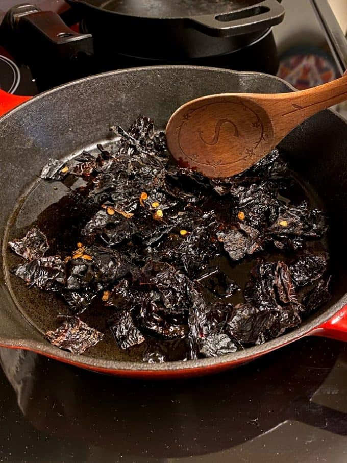 frying dried chile ancho pieces in cast iron skillet