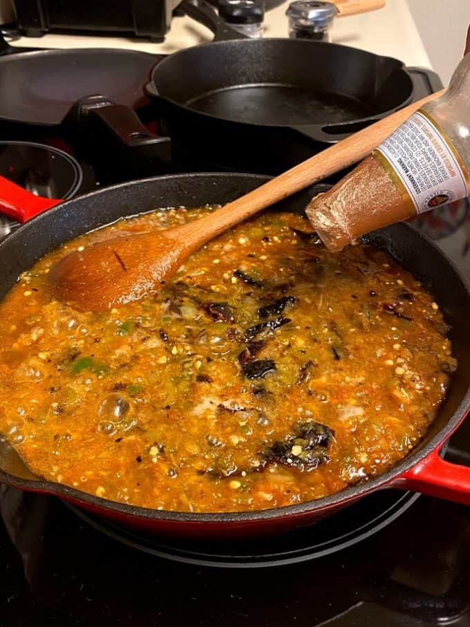 pouring beer into skillet for salsa borracha recipe