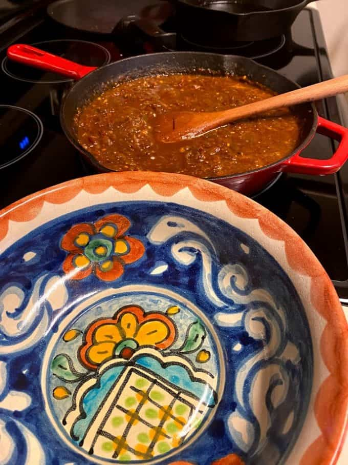 salsa borracha in skillet with empty serving bowl nearby