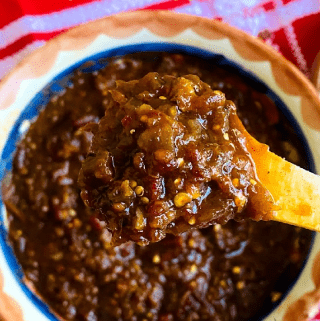 Salsa close up on wooden spoon