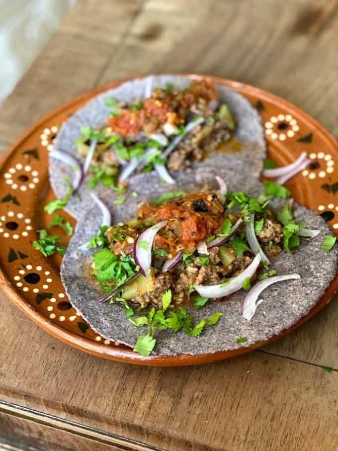 beef picadillo tacos on blue corn tortillas